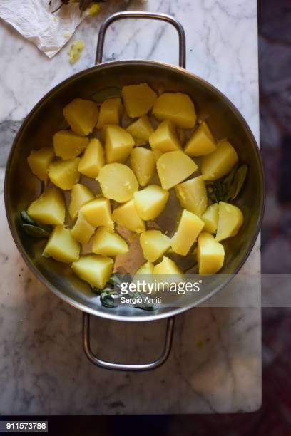 Cut boiled potatoes in a roasted tin