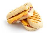 Cut cheese and ham toasted panini melt.
