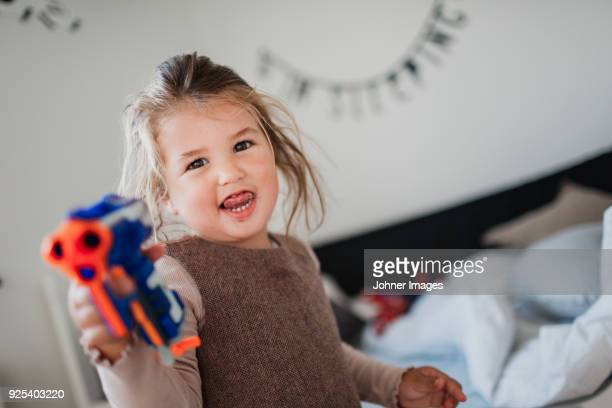 Cut girl playing with toys