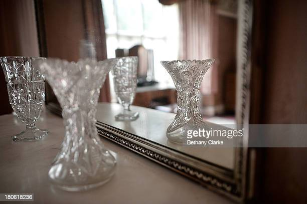 Cut glass vases on a mantle piece in one of the bedrooms in Pineheath house on September 4 2013 in Harrogate England The untouched 40bedroom house...