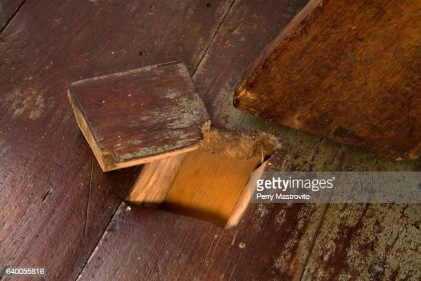 cut holes in floorboards - floorboard stock photos and pictures