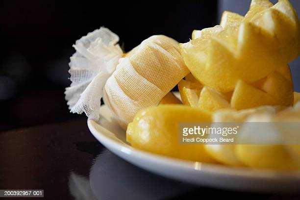 cut lemons on plate - heidi coppock beard bildbanksfoton och bilder
