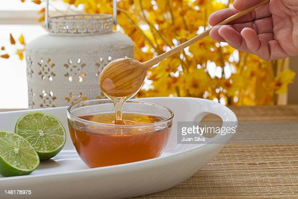 Cut lime and honey on a tray at  a spa