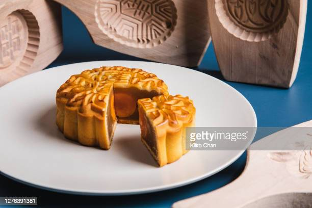 cut mooncake and mooncake molds - moon cake stock pictures, royalty-free photos & images