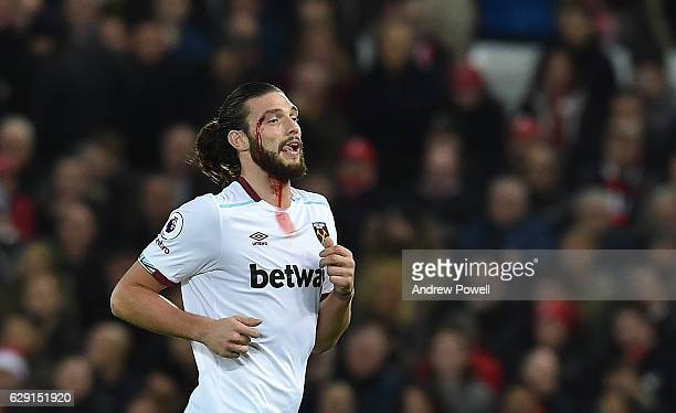 A cut on the head of Andy Carroll of West Ham bleeds during the Premier League match between Liverpool and West Ham United at Anfield on December 11...