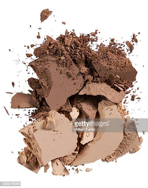 A cut out beauty product shot of brown eyeshadow