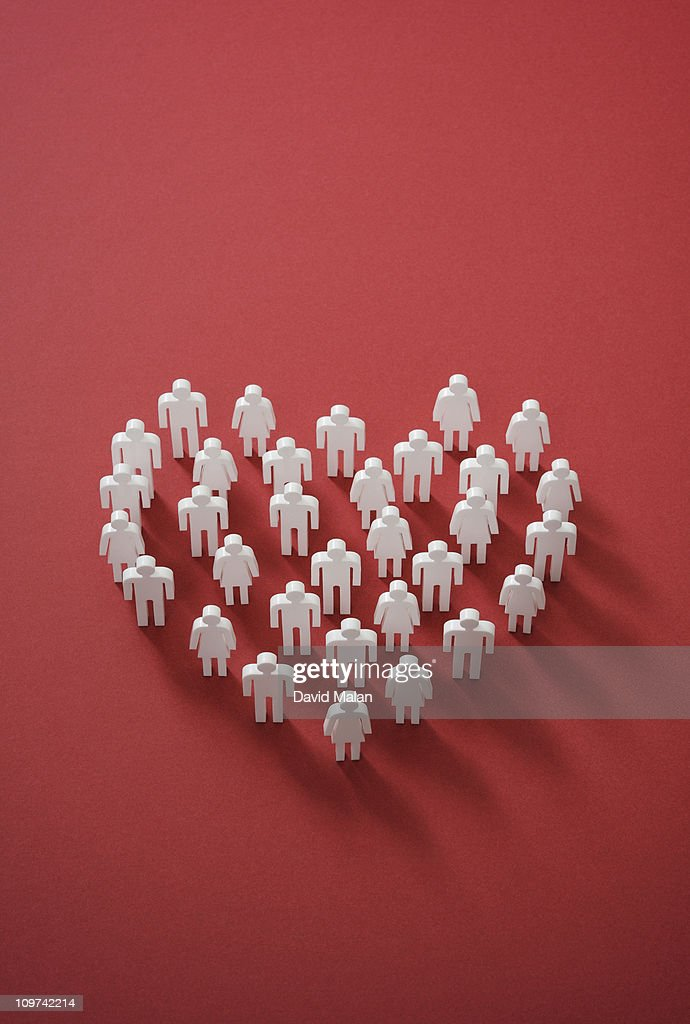 cut out figures forming a heart shape : Stock Photo