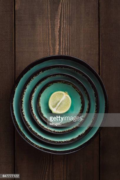 Cut Out Halved Lime in Crockery Bowls