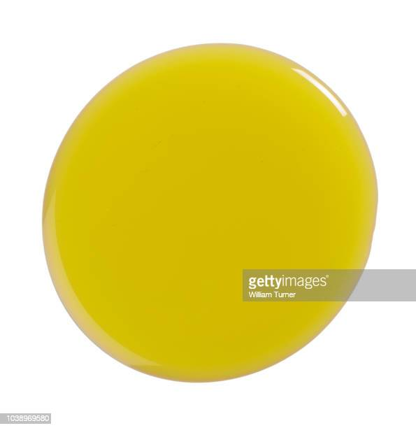 a cut out image of a circular pool, blob, drip or splash of olive oil - extra virgin olive oil stock pictures, royalty-free photos & images