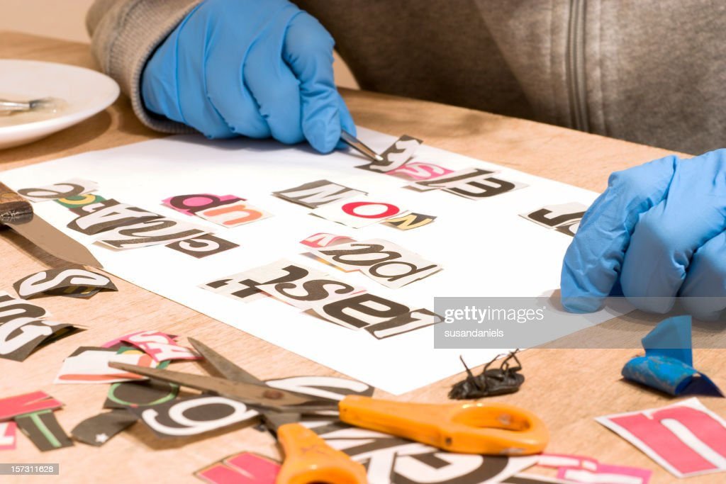Cut out magazine letters for blackmail letter : Stock Photo