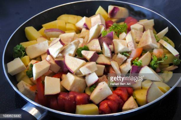 Cut Root Vegetables in a Cooking Pan
