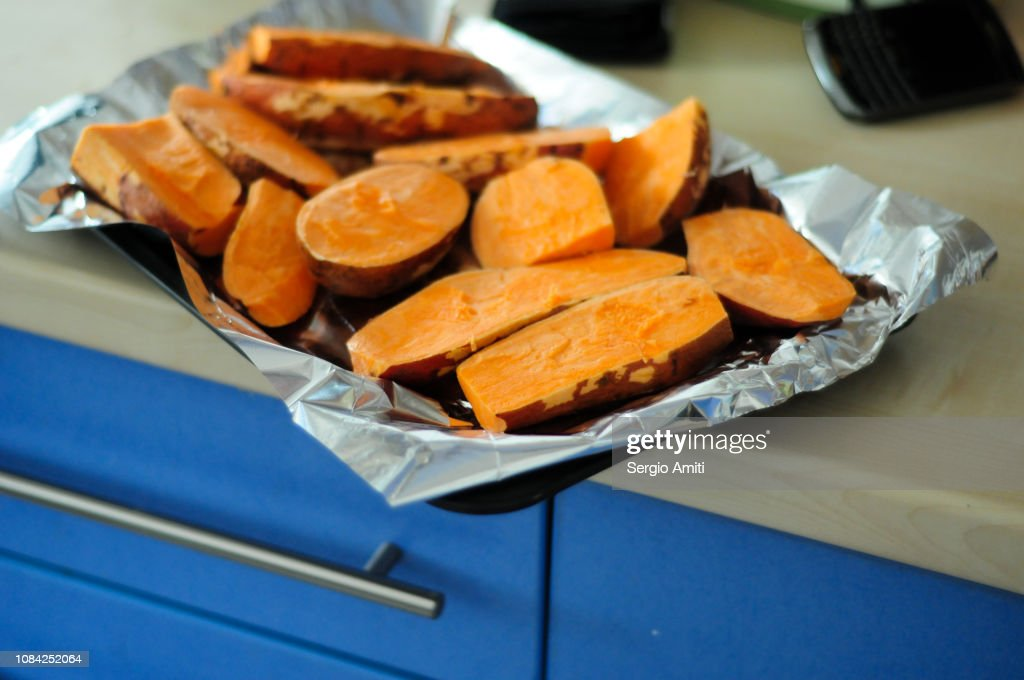 Cut sweet potatoes on a tray : Stock Photo