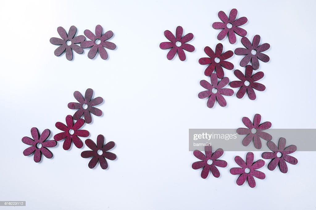 Cut wooden decorative flowers on white background : Stock Photo
