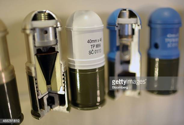 Cutaway models of 40mm NATO X46 grenade launcher projectiles stand on display in the showroom at the staterun Sloboda AD ammunitions plant in Cacak...