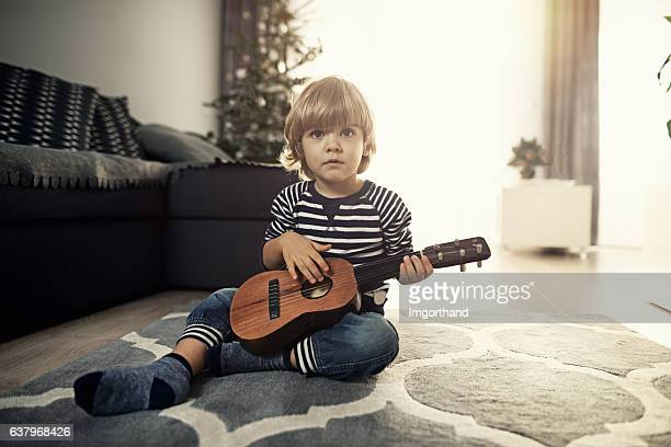 cute 2 years old little boy playing guitar - 2 3 years stock pictures, royalty-free photos & images