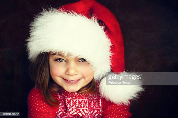 Cute 4 year old girl in Santa hat