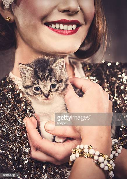 Cute 8 weeks old cat and beautiful woman
