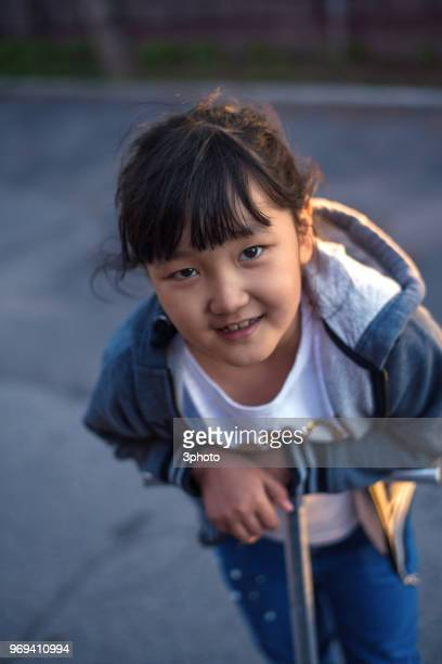Cute 8 years girl with scooter
