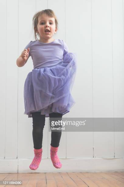 cute active four years old girl jumping and dancing - mmeemil stock pictures, royalty-free photos & images