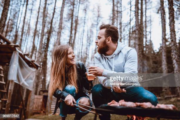 Cute Adolescent Couple Drinking Beer And Making Barbecue