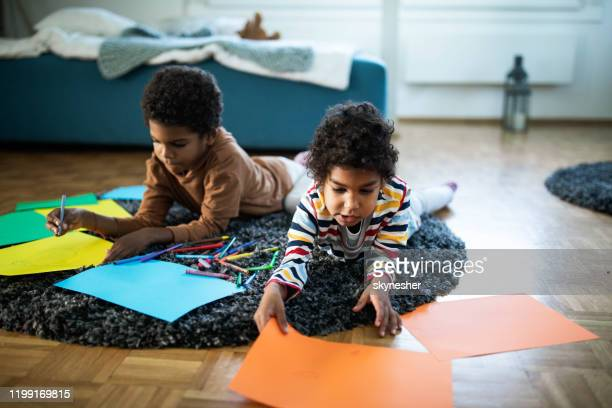 cute african american siblings coloring on carpet at home. - coloring stock pictures, royalty-free photos & images