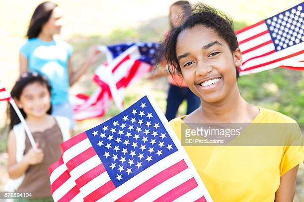 Cute African American teenager celebrates Independence Day