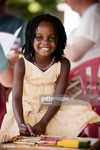 cute african girl drawing - uganda stock pictures, royalty-free photos & images