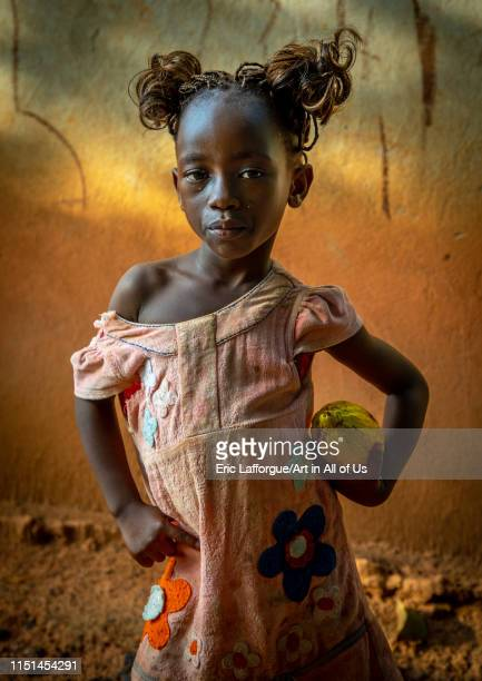 Cute african girl with a cocoa fruit pod in her hands Savanes district Yamoussoukro Ivory Coast on May 7 2019 in Yamoussoukro Ivory Coast