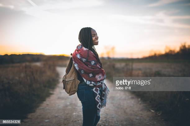 Cute african woman hiking
