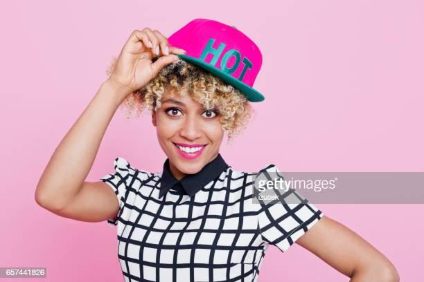Cute afro american young woman wearing baseball cap