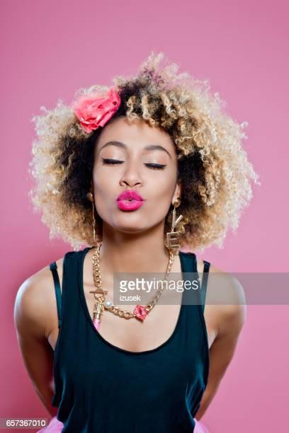 Cute afro woman sending kiss