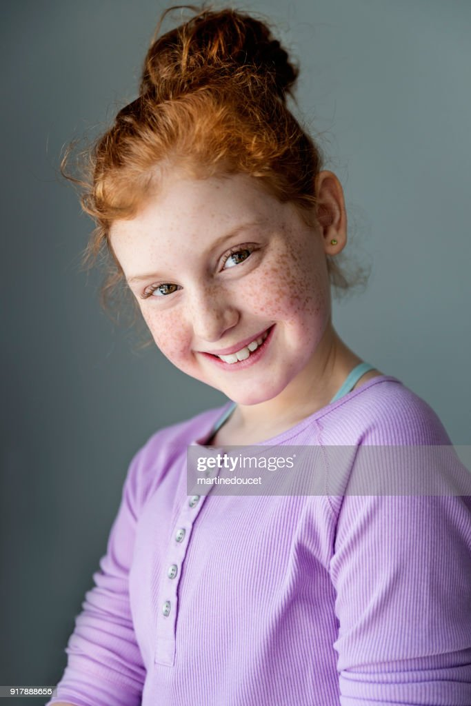 Cute and expressive preteen girl with redhead portrait. : Stock Photo