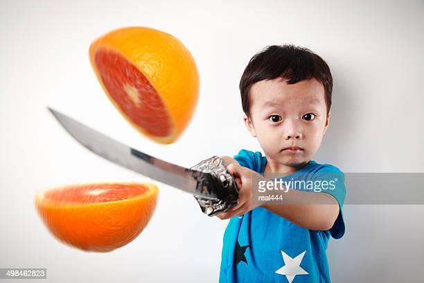 Cute asia children cut fruit