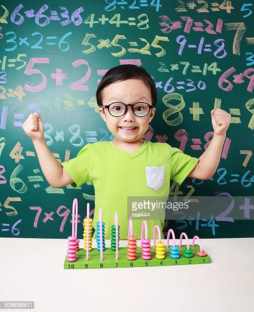 Cute asia children do arithmetic