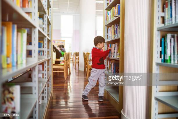 Cute asia children in the library
