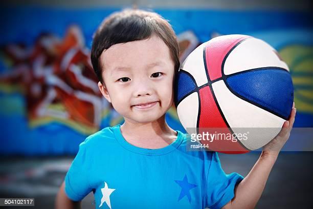 Cute asia children playing basketball