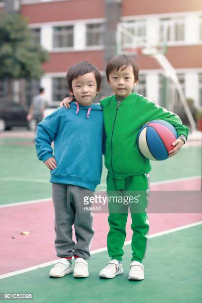 Cute asia children playing basketball