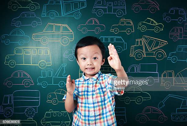 Cute asia children playing with toy cars