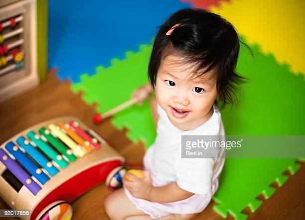 Cute Asian Baby Girl Playing