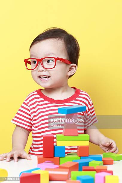 Cute Asian baby playing with blocks