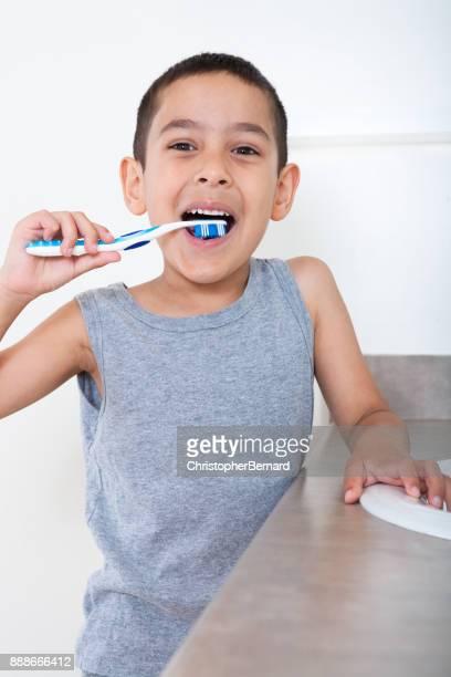 Cute asian boy brushing teeth