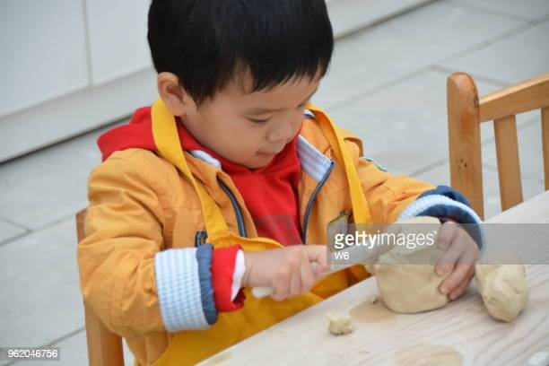 cute asian boy playing clay - clay stock pictures, royalty-free photos & images