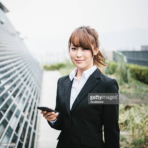 Cute Asian Businesswoman on a Rooftop