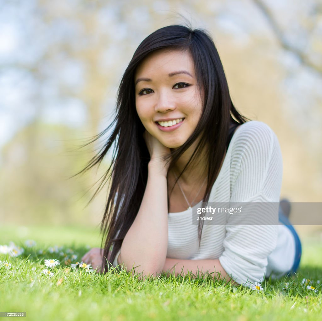 cute asian woman at the park stock photo | getty images