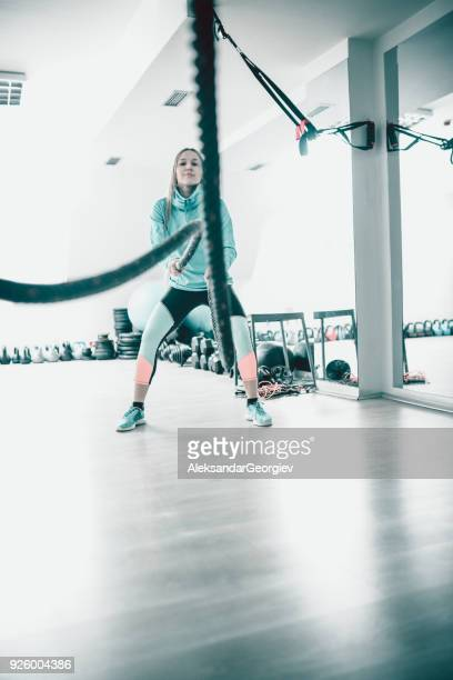 Cute Athlete Female Make Battle Rope Exercise in the Gym