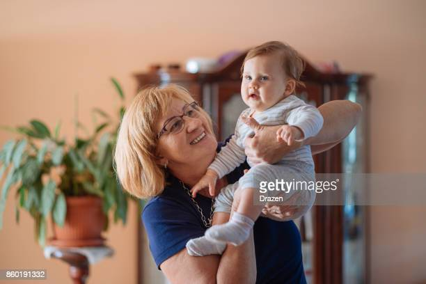 cute baby and happy granny - fat granny stock pictures, royalty-free photos & images