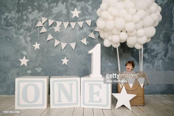 cute baby boy celebrating first birthday in beautiful light blue decorations - 1歳以上2歳未満 ストックフォトと画像