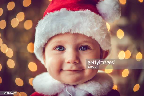 cute baby boy in christmas - santa face stock photos and pictures