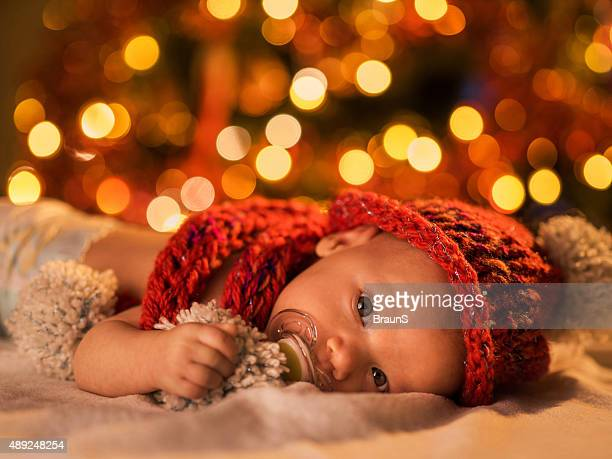 Cute baby boy with knit hat in New Year's Eve.