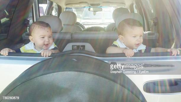 Cute Baby Boys Sitting In Car